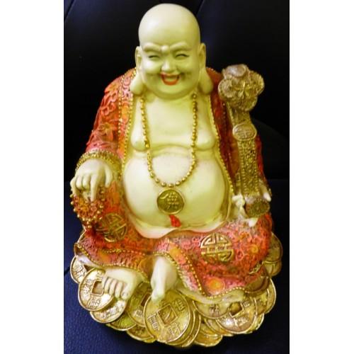 Γελαστός Βούδας πάνω σε νομίσματα